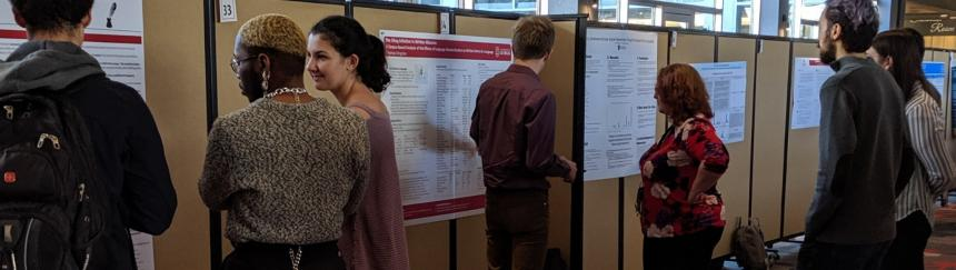 Students presenting posters at conference