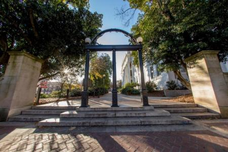 Image of the UGA Arch on North Campus with trees and buildings in background